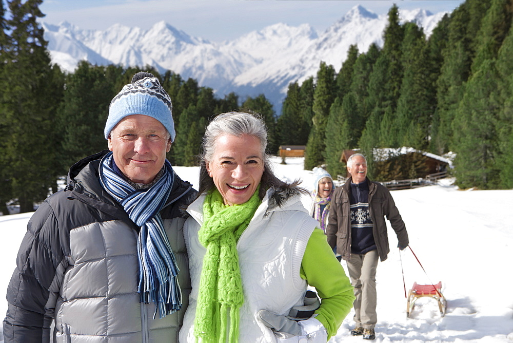 Portrait of smiling senior couple in snowy woods