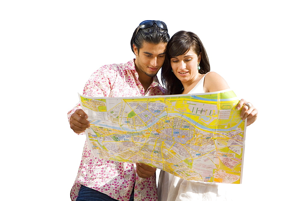 Cut Out Of Couple On Holiday Looking At Map