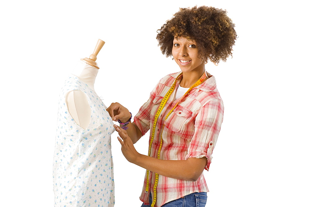 Cut Out Of Female Teenage Student Studying Fashion