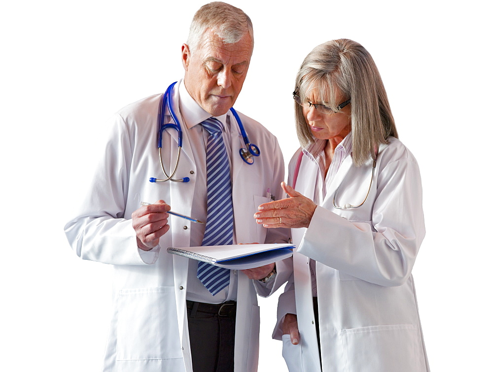 Cut Out Of Senior Male  And Female Doctor Wearing White Coat