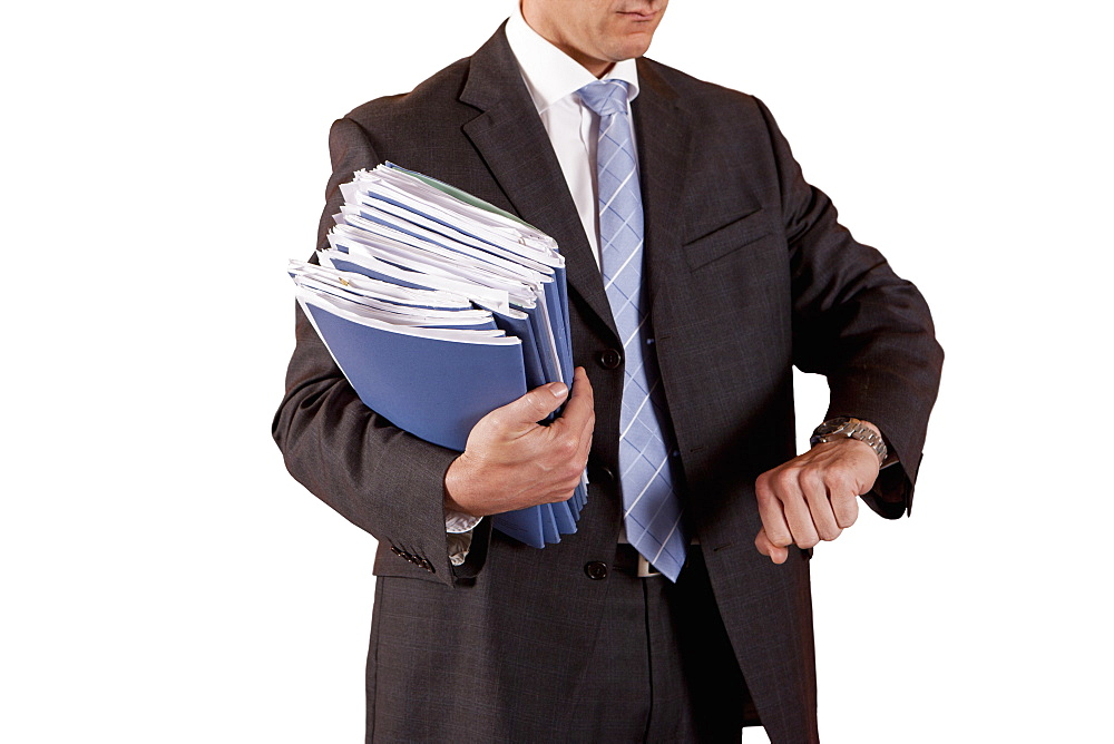 Cut Out Of Middle Aged Male Executive Holding Documents And Checking Watch