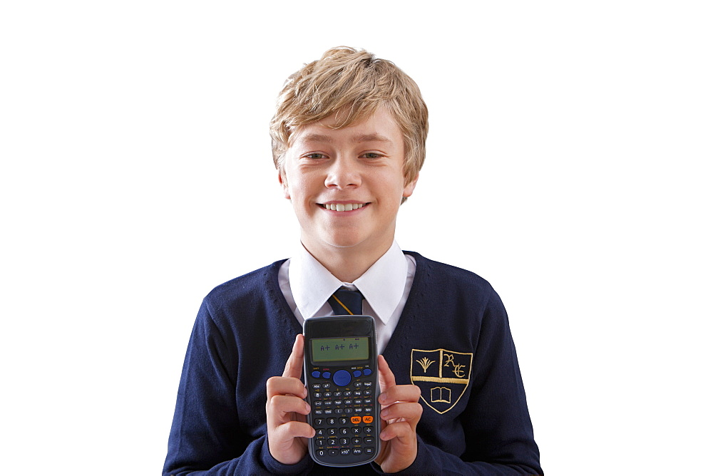 Cut Out Of Male School Pupil Using Calculator In Maths Lesson