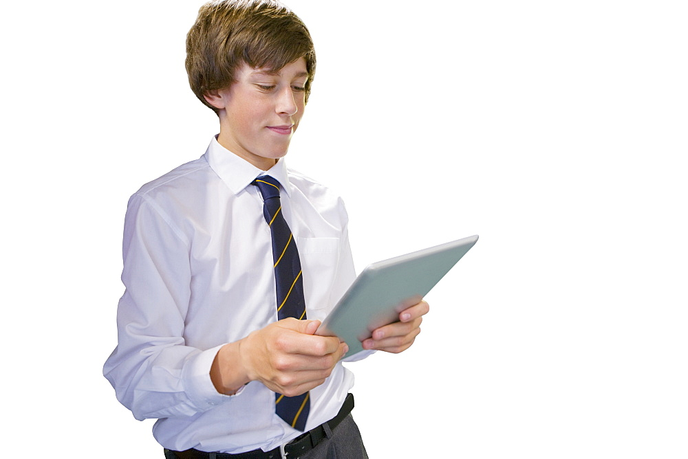 Cut Out Of Male School Pupil Using Digital Tablet