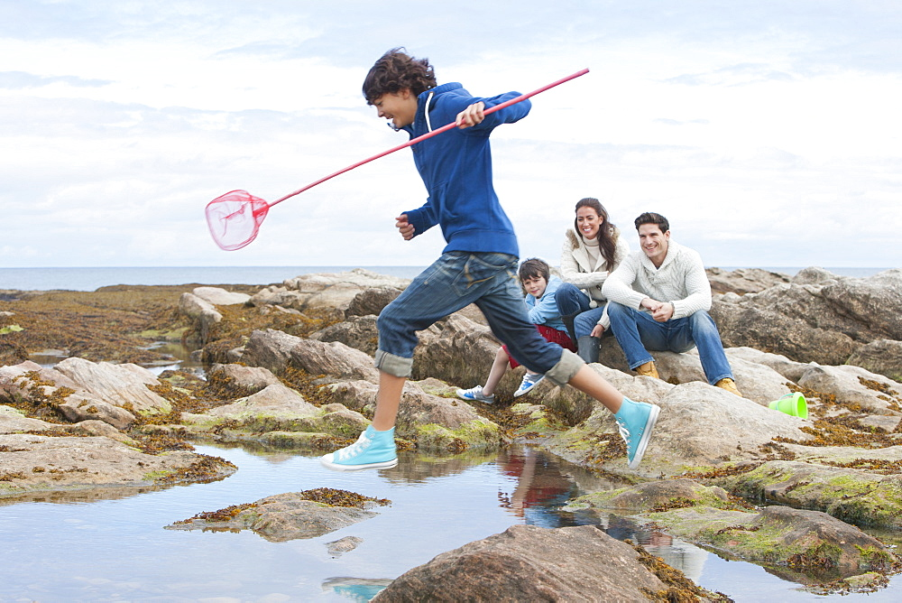 Family Exploring Rockpools Together - 786-8494