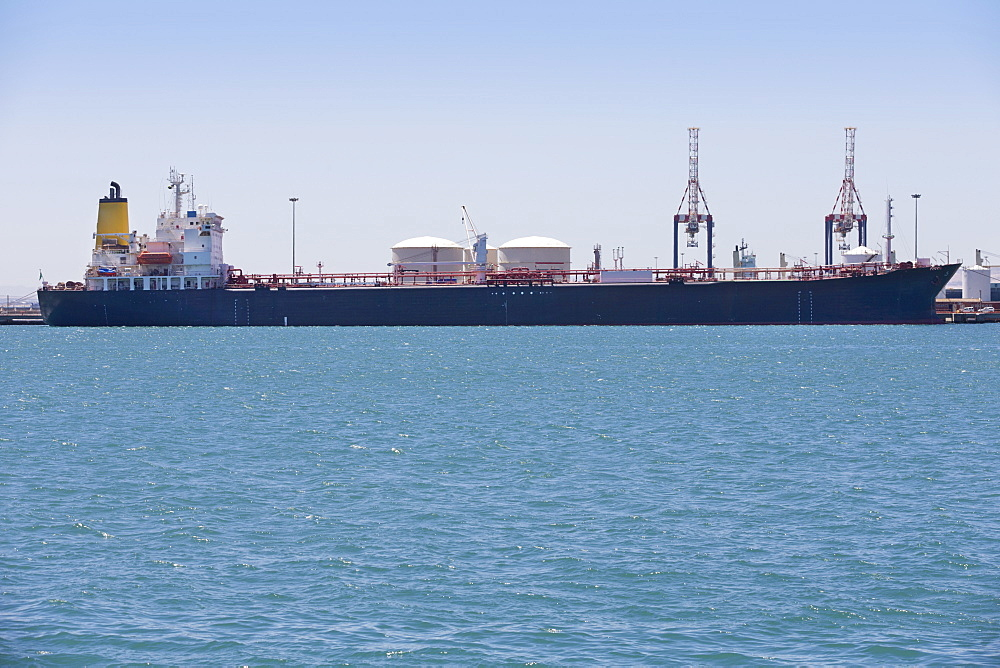 Oil tanker moored at commercial dock