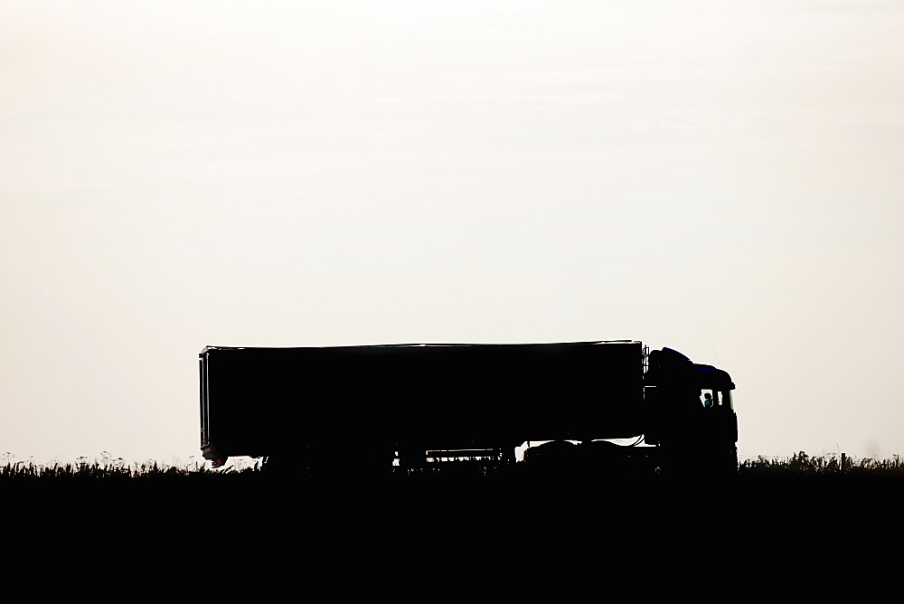 Silhouette Of Lorry Transporting Grain On Farm