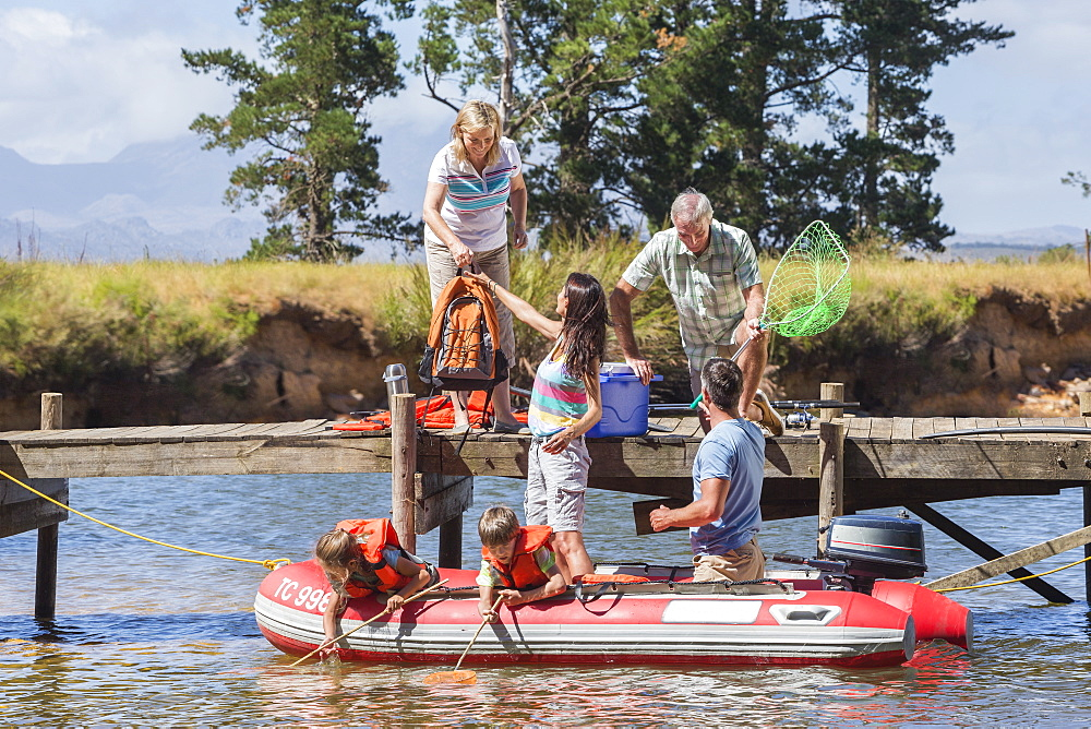 Multi-Generation Family Enjoying Boat Trip On Lake
