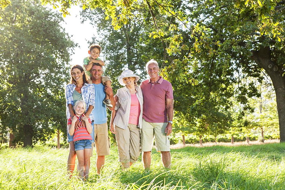 Multi-Generation Family Enjoying Walk In Beautiful Countryside