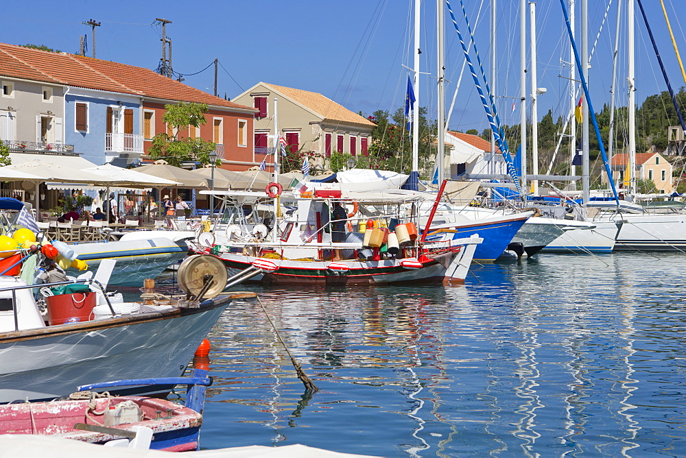 Greece, Kefalonia, Fiskardo, Boats in sunny Harbour