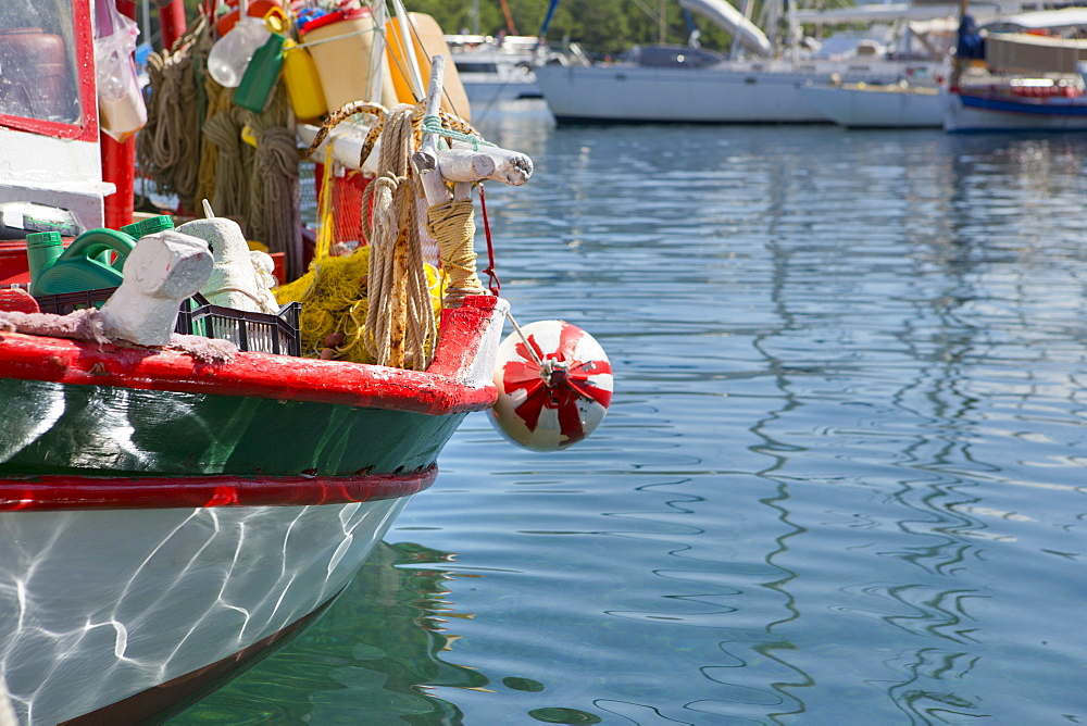 Greece, Kefalonia, Fiskardo, Relection of water on hull of boat in harbour