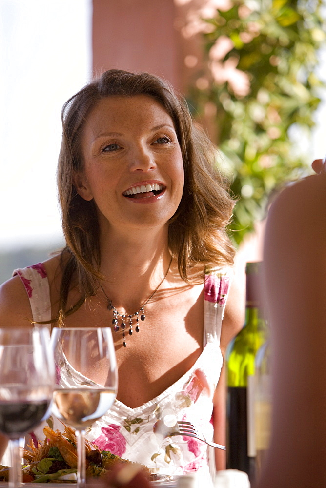 Woman dining at patio table