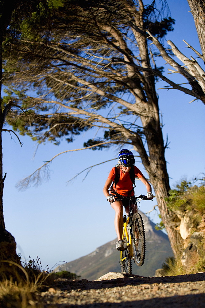Woman riding mountain bike in remote area
