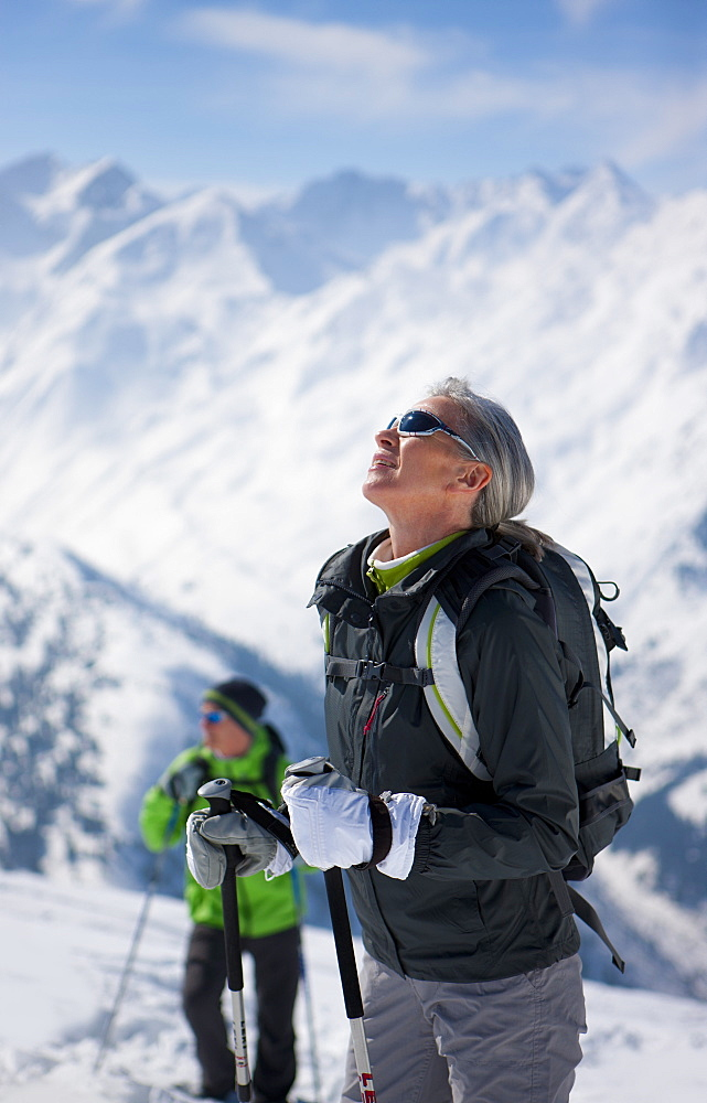 Couple hiking on mountain top in snow