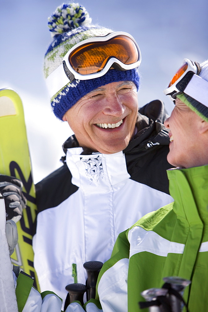 Smiling skiers standing together