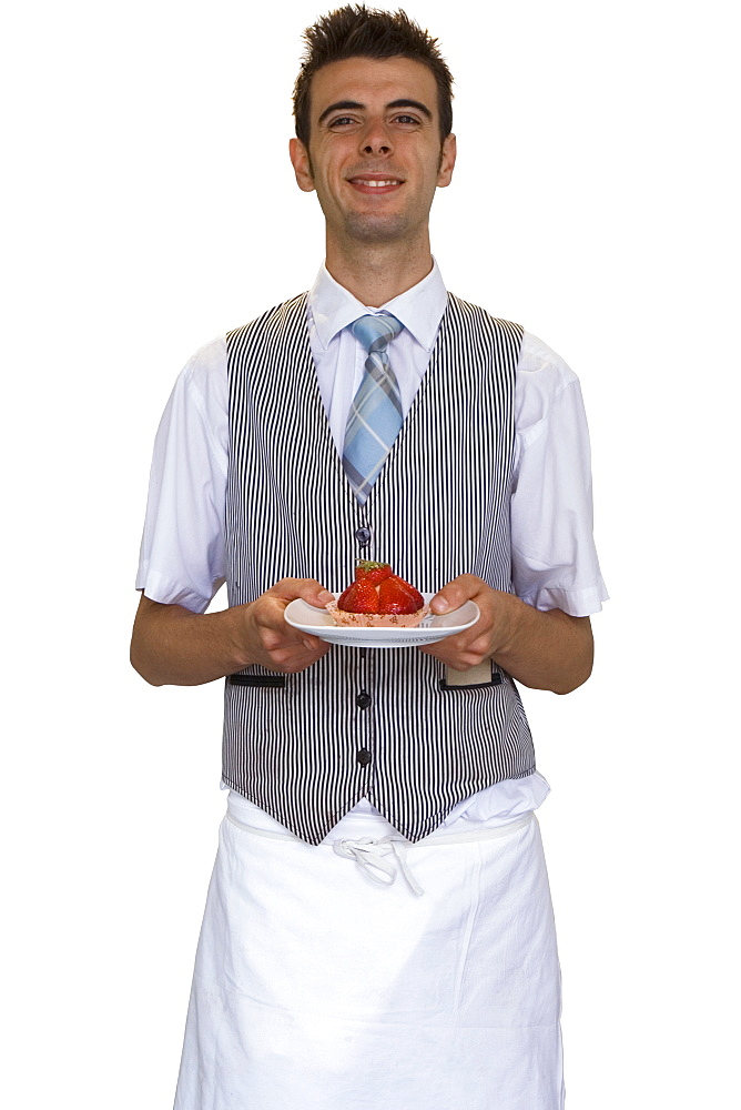 Cut Out Of Male Waiter Carrying Dessert Facing Camera