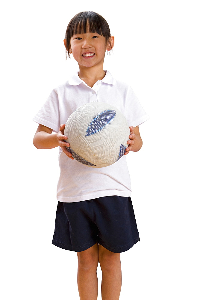 Cut Out Of Schoolgirl Holding Football