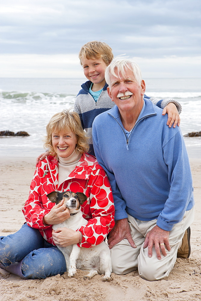 Portrait Of Grandparents And Grandson On Beach With Dog - 786-8482