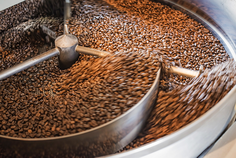 Machinery at a coffee bean processing shed roasting coffee beans, New York state, USA