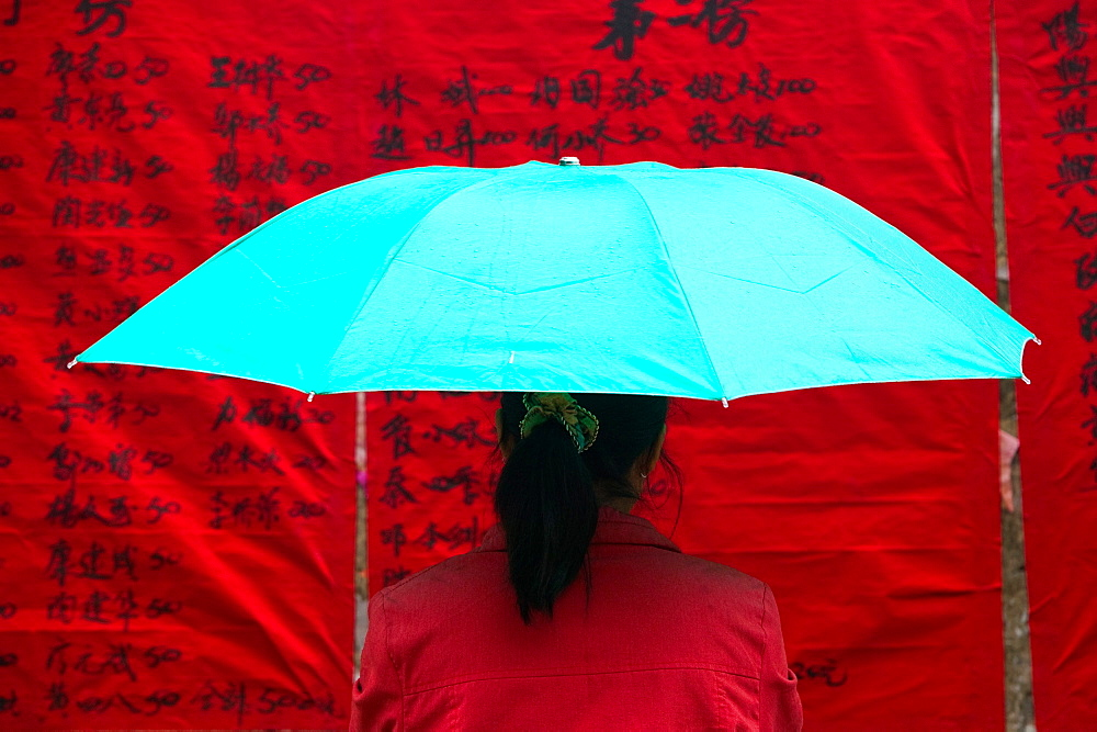 Woman under umbrella, China, China