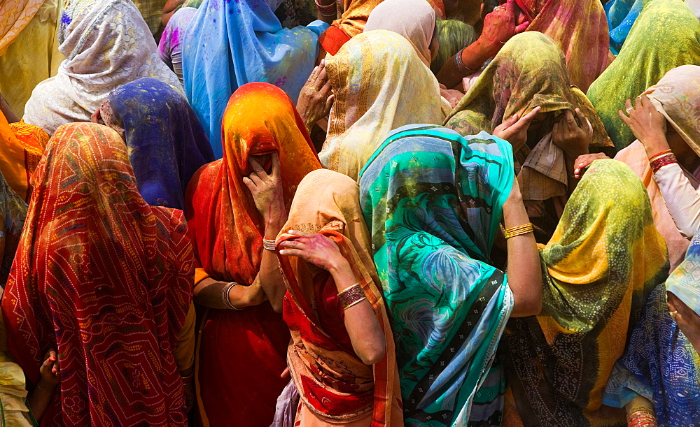 A colourful crowd of people celebrate the Holi Festival, Mathura, Uttar Pradesh, India, Mathura, Uttar Pradesh, India