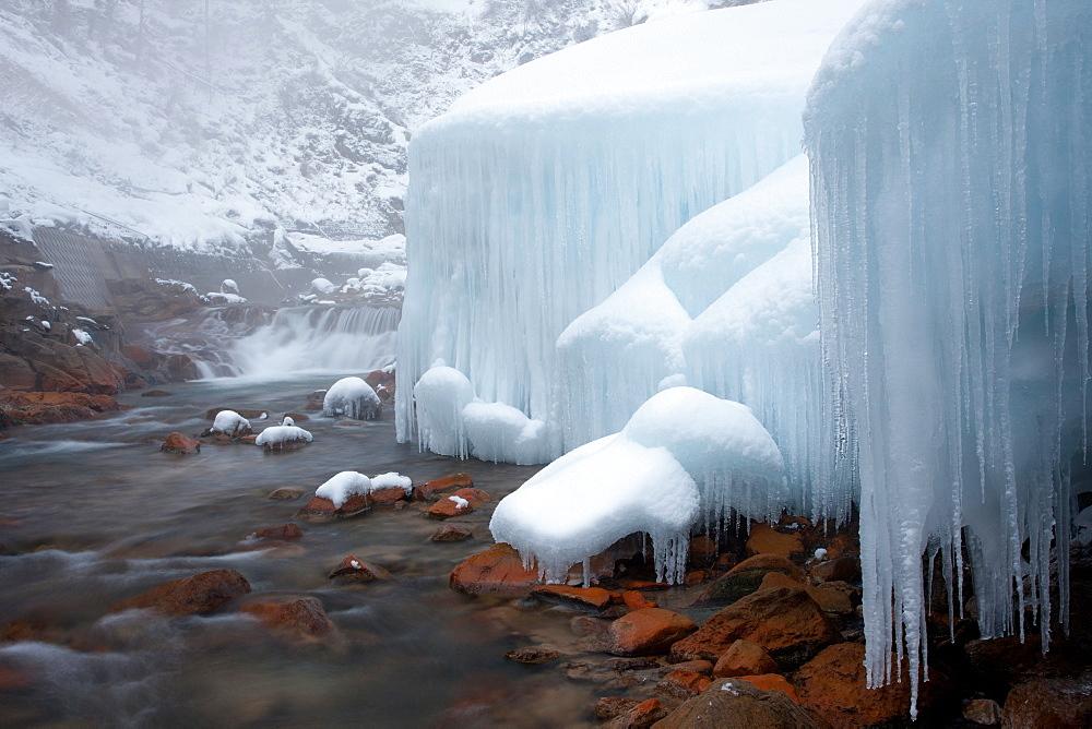 Honshu island, Nagano, Japan. Icicles and blocks of frozen snow by a stream, Honshu island, Nagano, Japan