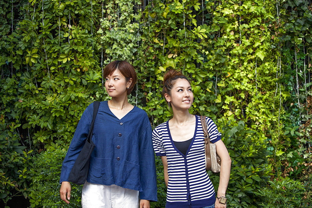 Two women standing side by side, Osaka, Japan