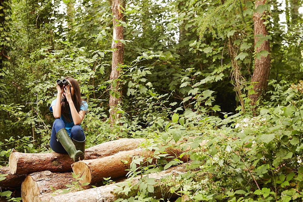 A young girl, a birdwatcher, Bristol, Avon, England