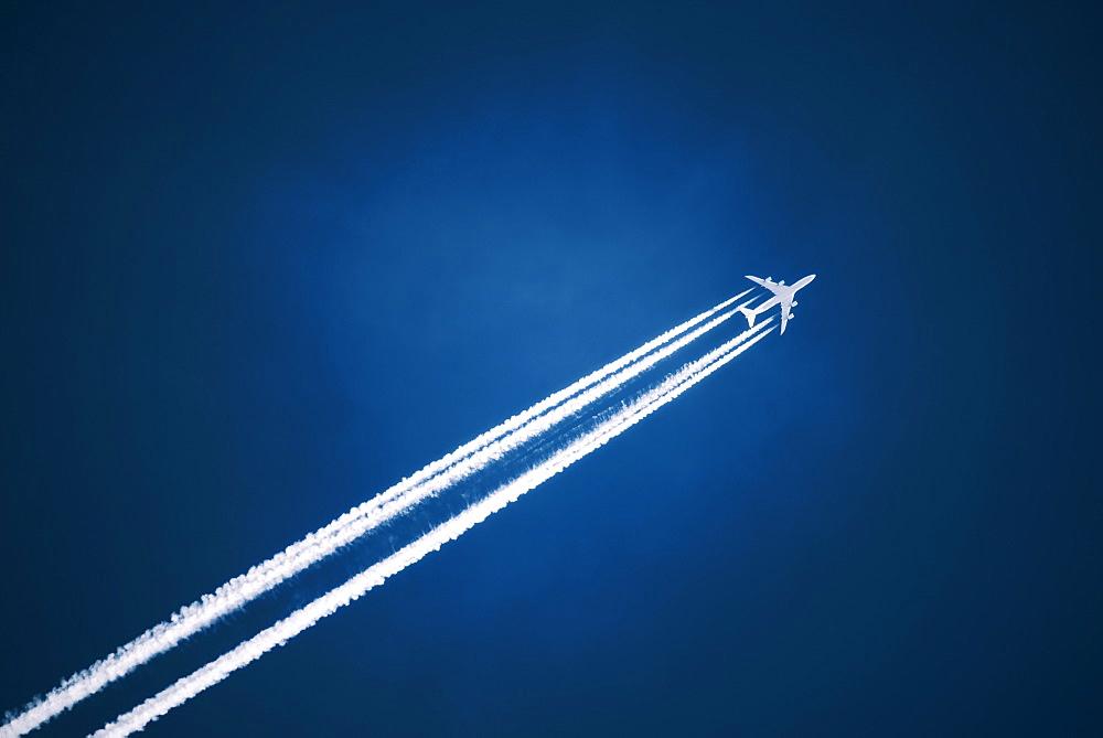 A jet vapour trail across a dark blue sky, Jet contrail, Saskatchewan, Canada