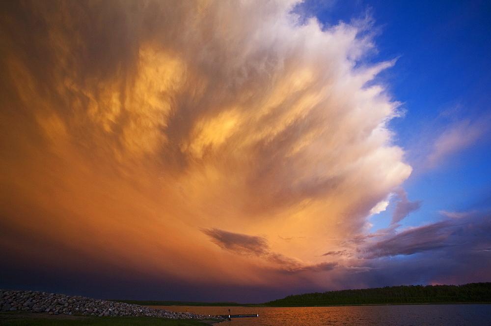 A cloud formation, a storm cloud reflecting sunlight, Storm cloud, Saskatchewan, Canada