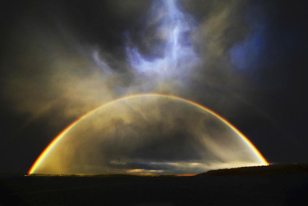 The arc of a rainbow over the landscape, Saskatchewan, Canada