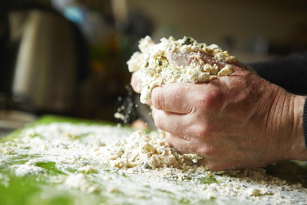 A man mixing flour for fresh pasta, England, United Kingdom