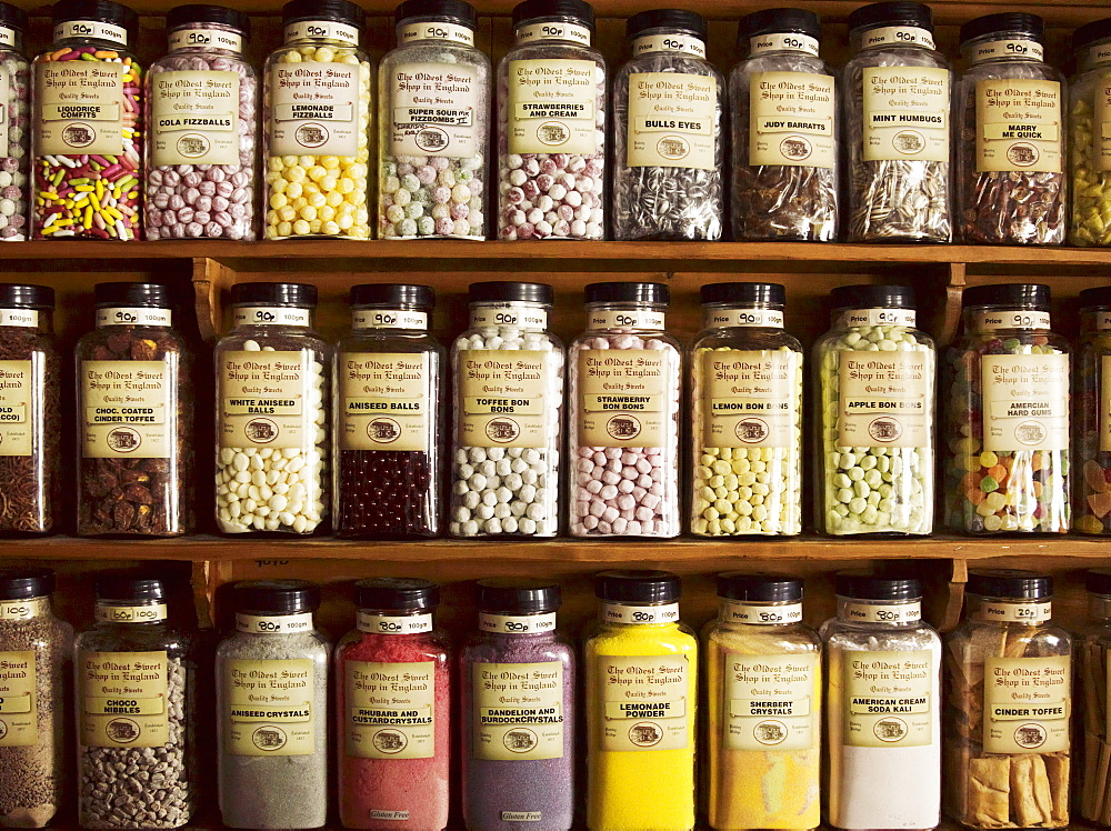 Traditional sweets displayed in tall glass jars on the shelves of a sweet shop, Sweet Shop, Yorkshire, England