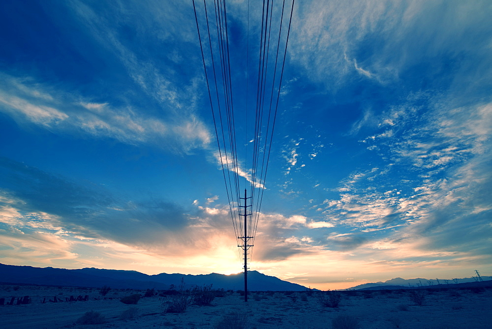 Power lines on poles reaching into the distance, in a mountain landscape, Hydro Lines, USA