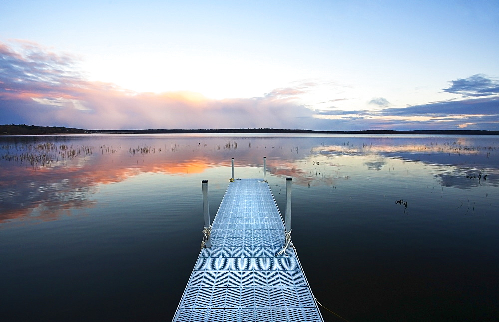 View over a calm lake, and a dock out over the water, Dock on lake, Canada