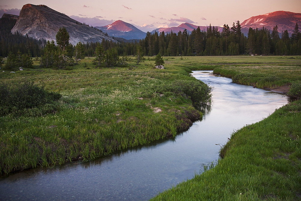 View of a river running through the Tuolumne Meadows in California at dusk.