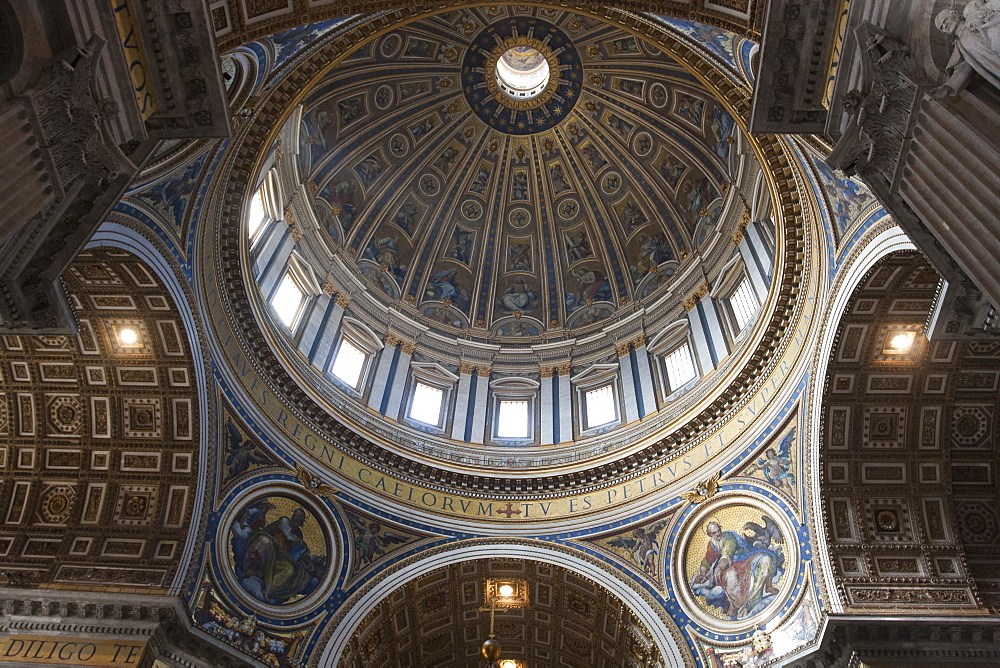 Low angle interior view of the dome of St. Peter's Basilica in Vatican City, Rome.