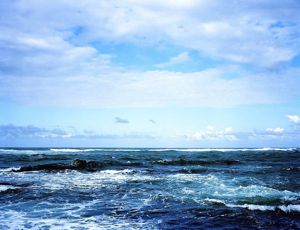 View across a wavy ocean under a cloudy sky, United States of America