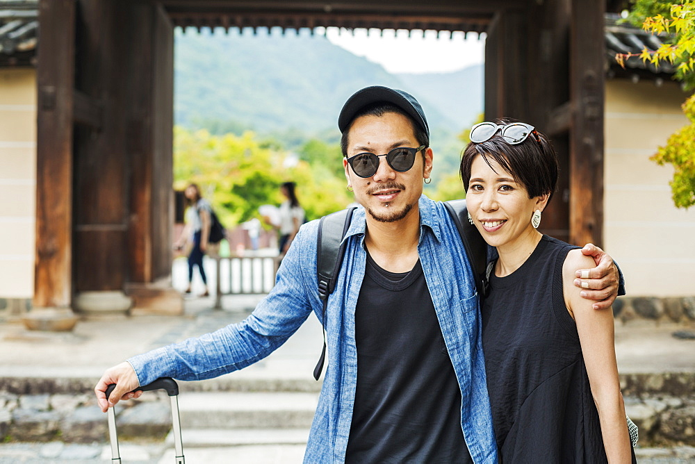 A man and woman visiting a historic temple in Japan, Japan