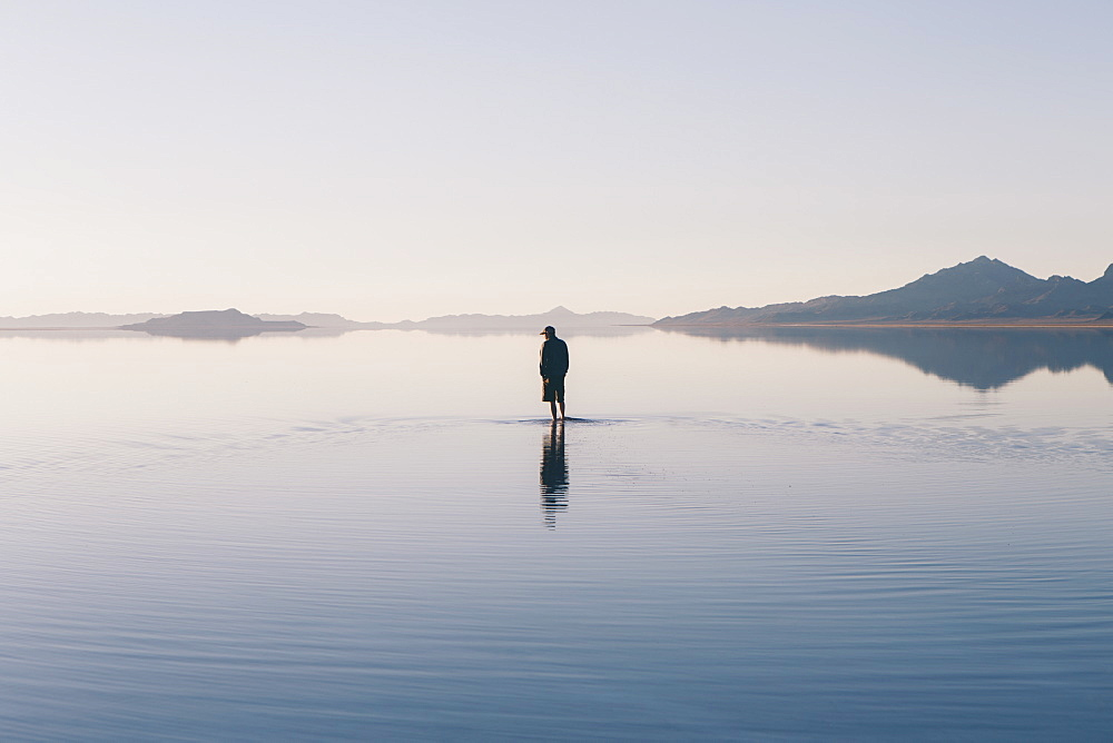 Man walking on vast and flooded Bonneville Salt Flats, Utah, United States of America