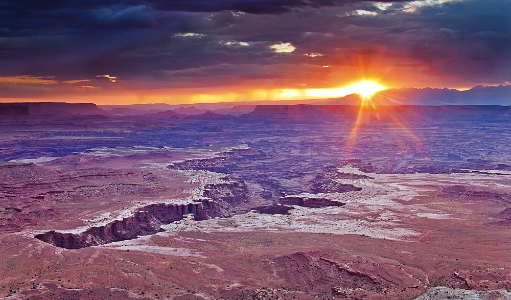 Sunset over the arid landscape of Canyonlands National Park, from the White Rim Overlook.