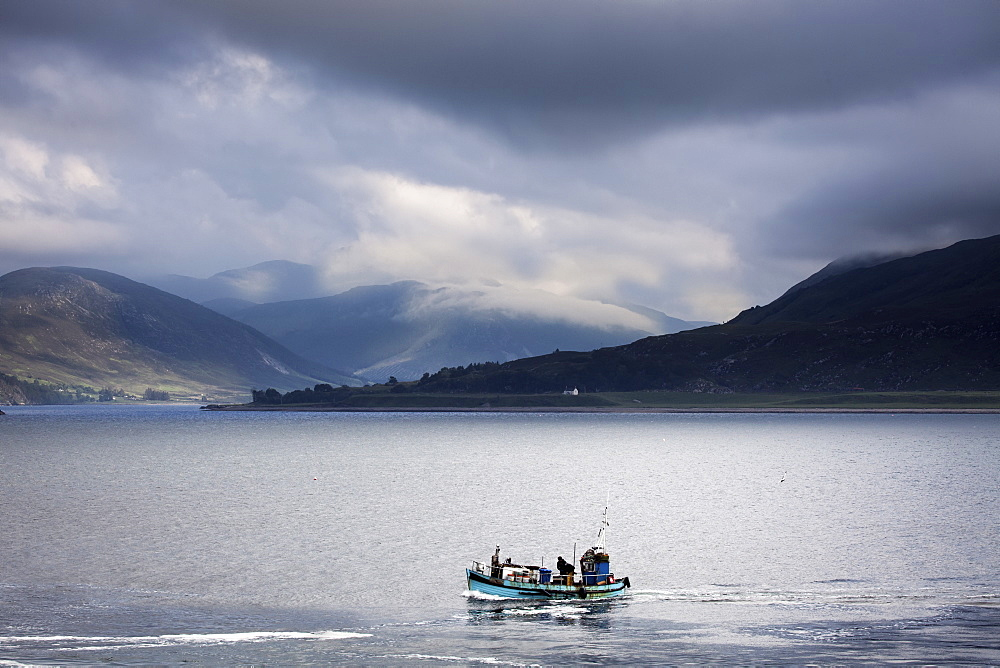 A small group of people in a fishing boat on a large body of water.
