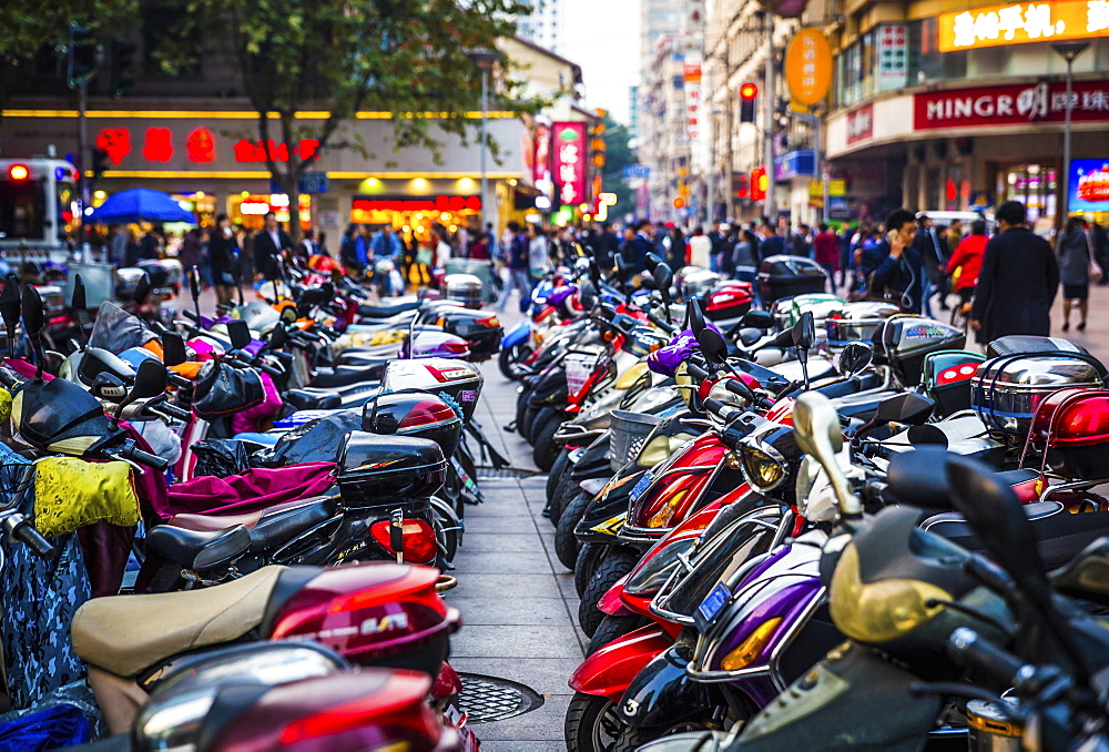 Parked motorcycles in the city square. - 1174-4435