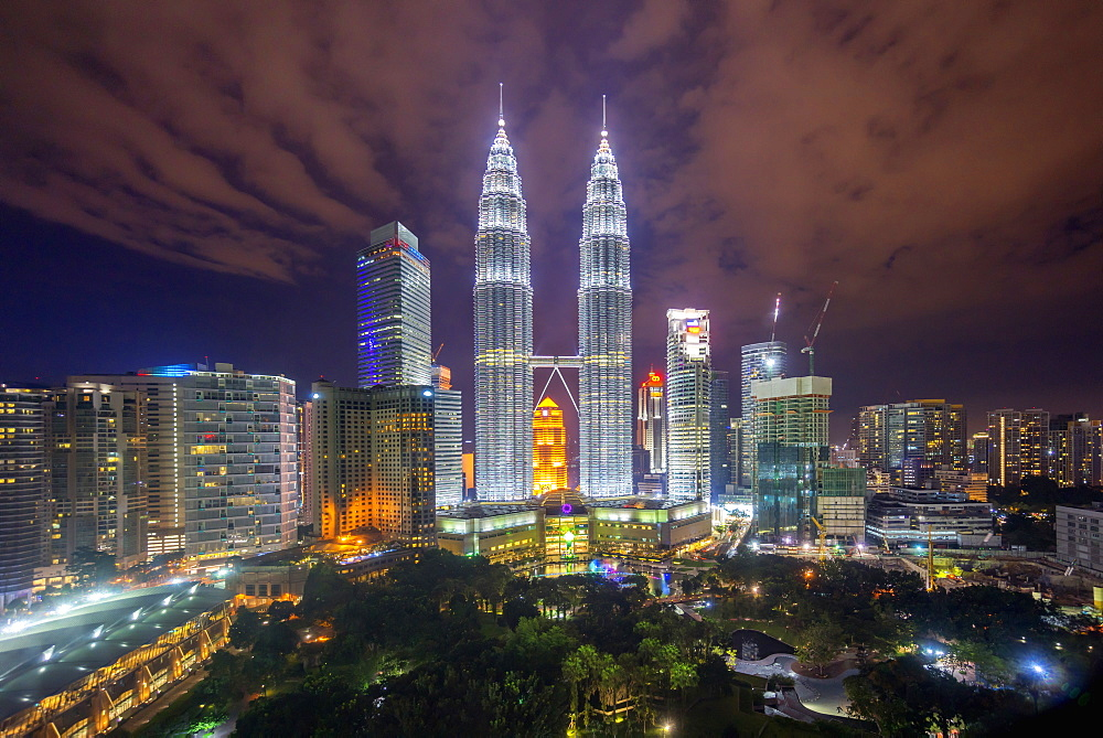 Kuala Lumpur city at night, tall towers and skyscrapers