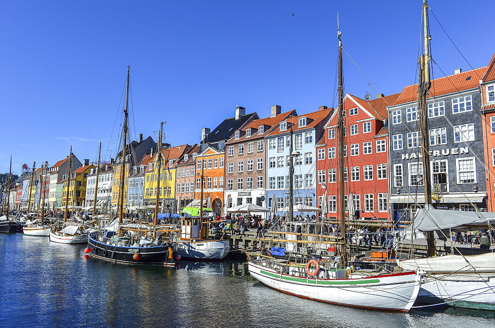 Nyhavn, the 17th century waterfront with row of colourful historic buildings, promenade and moored sailing ships in Copenhagen, Denmark, Copenhagen, Denmark