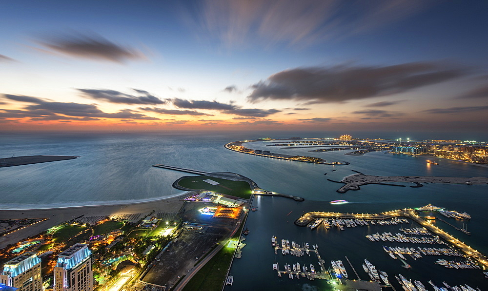 Aerial view of marina and Persian Gulf at dusk, Dubai, United Arab Emirates, Dubai, United Arab Emirates