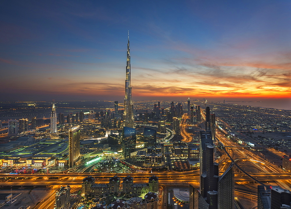 Cityscape of Dubai, United Arab Emirates at dusk, with the Burj Khalifa skyscraper in the distance, Dubai, United Arab Emirates