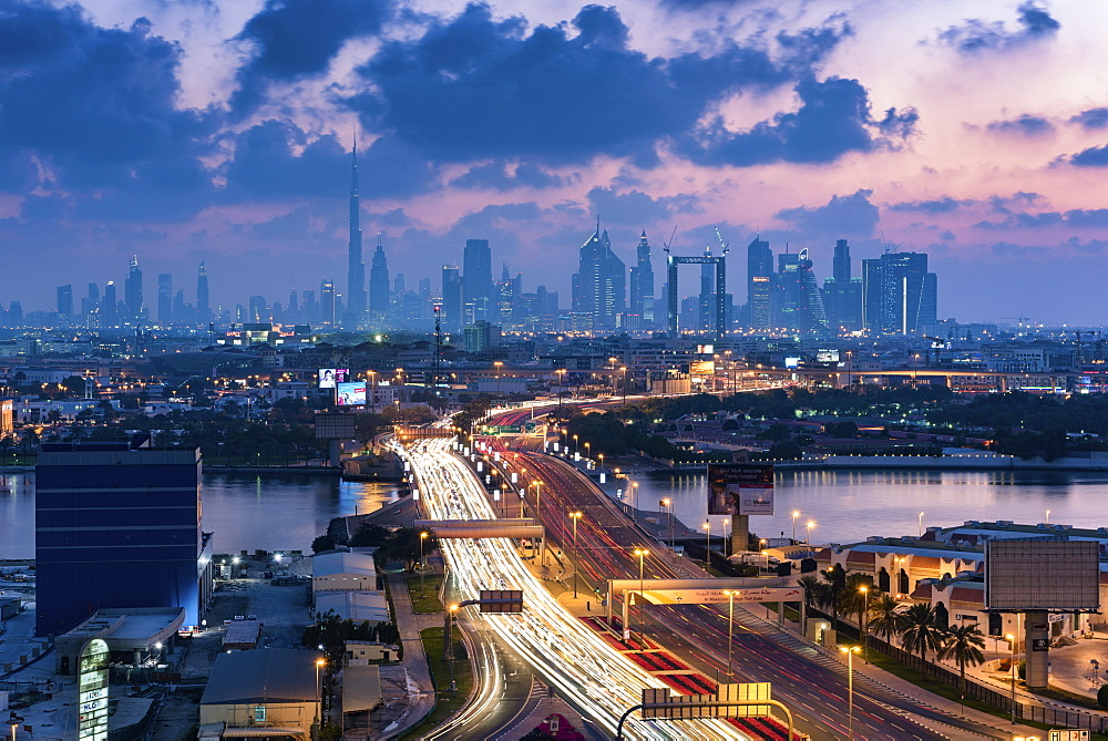 Cityscape of the Dubai, United Arab Emirates at dusk, with highway across the marina and skyscrapers in the distance, Dubai, United Arab Emirates