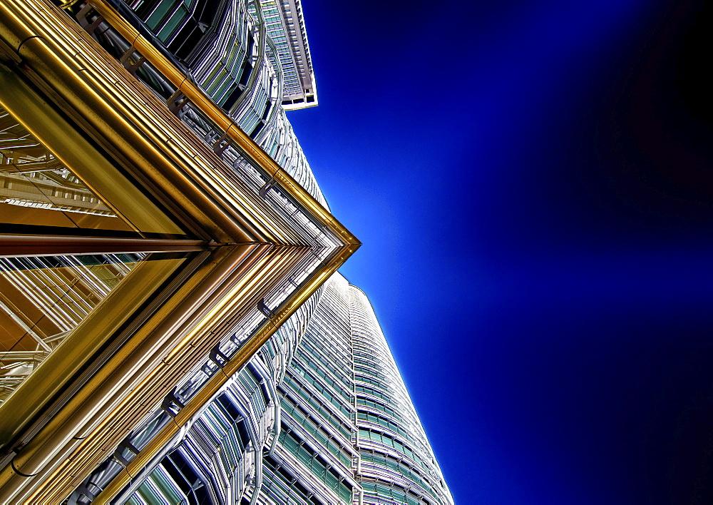 Low angle close up of architectural detail on Petronas Towers in Kuala Lumpur, Malaysia at night, Kuala Lumpur, Malaysia