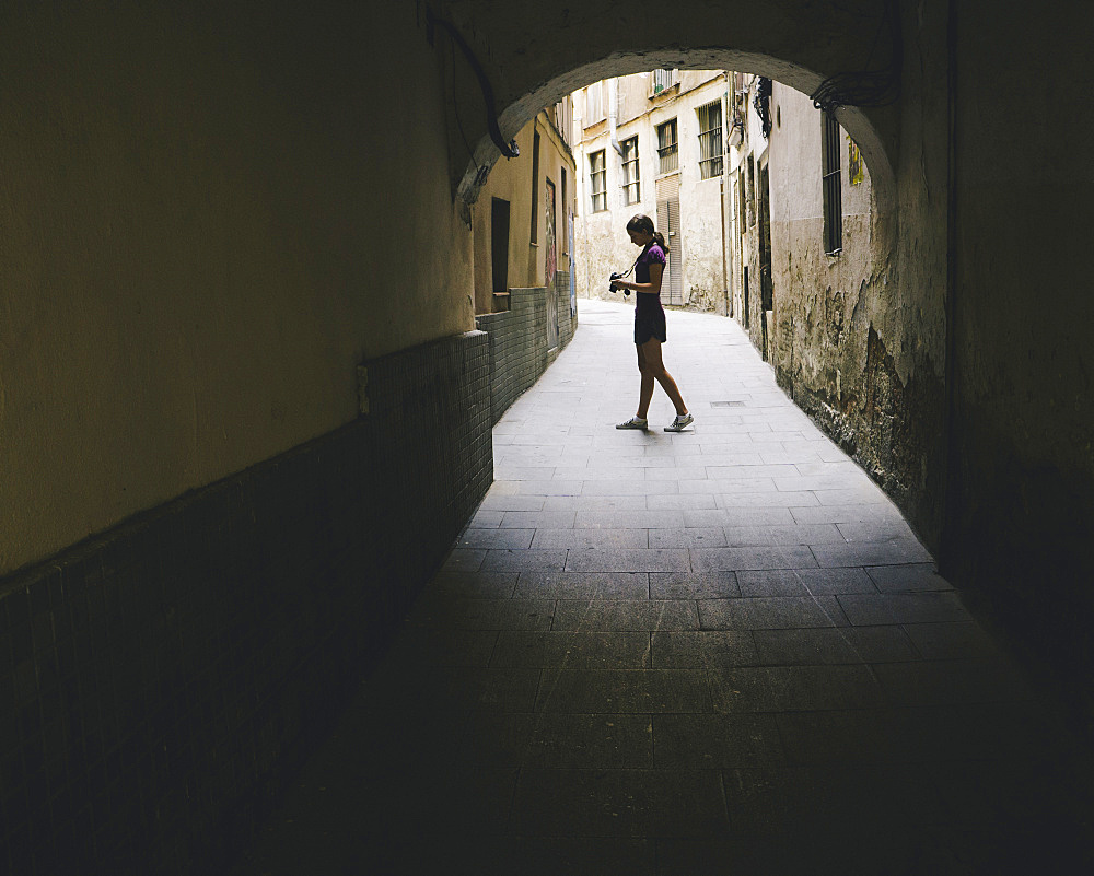 Teenage girl composing photo with digital camera, Gothic Quarter, Barcelona, Spain, Spain