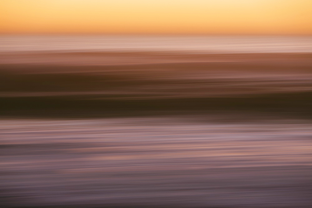 Abstract seascape with horizon over ocean at dusk.
